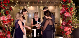 Lighting the unity candle with moms